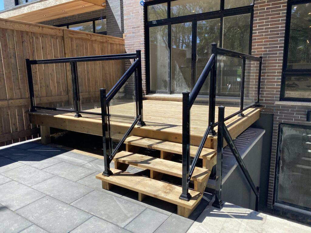 patio railing with aluminum and glass on a rear deck in toronto