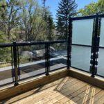 glass railing with privacy panel on a new deck in toronto