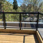 aluminum glass railing on a new deck