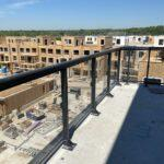 glass railing on balcony of a new construction site in Mississauga