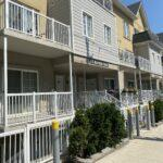 white aluminum railing on stacked town houses