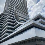 panel railing with glass on new condo in toronto