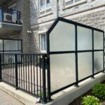 glass privacy divider and black aluminum railing