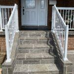 aluminum stair railing in white on a front porch in toronto
