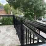black aluminum railing on a front porch in toronto