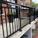 black aluminum railing on front deck in downtown toronto