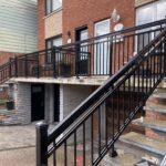 black aluminum railing on semi-detached house