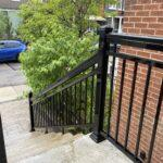 aluminum railing going down a stair case in Toronto