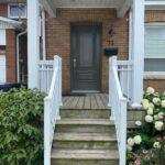 Aluminum porch railing and columns in white on a front porch in toronto