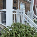 white aluminum railing and columns on a front porch in Toronto