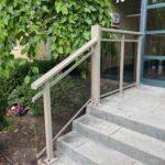 aluminum railing with glass on a stairs for an apartment building in toronto