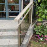 aluminum railing with glass on a stair case in toronto