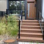 Aluminum railing with glass in black on a front porch in toronto