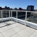 white aluminum glass railing on patio