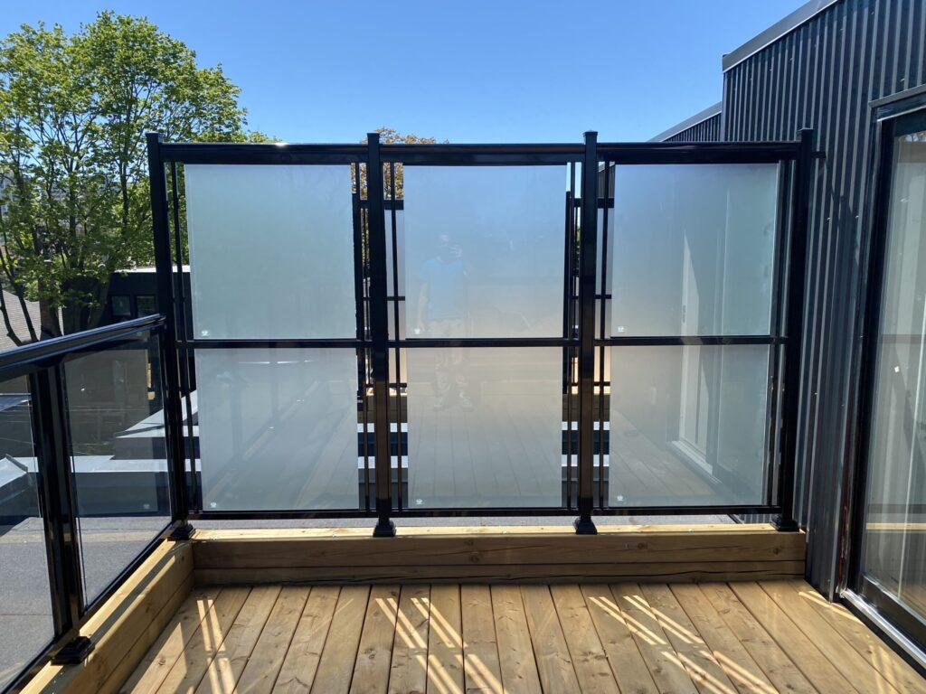 glass privacy divider on a deck in Toronto
