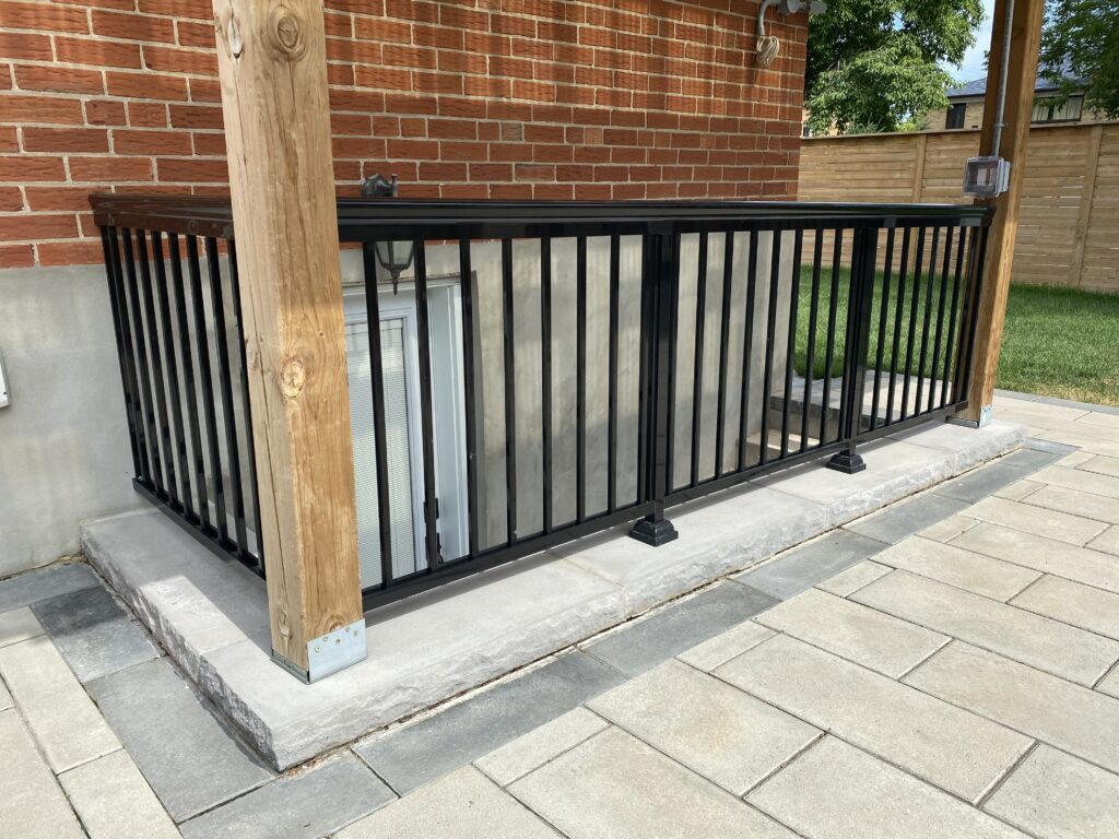 A bench in front of a brick building  Description automatically generated