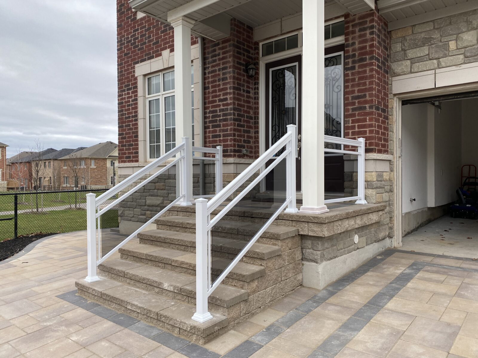 glass railing on a front porch in Oakville