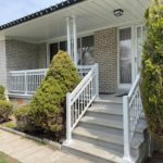white porch railing with decorative scroll